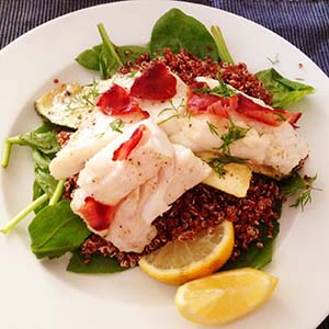 Pangasius on a bed of spinach, quinoa and zucchini